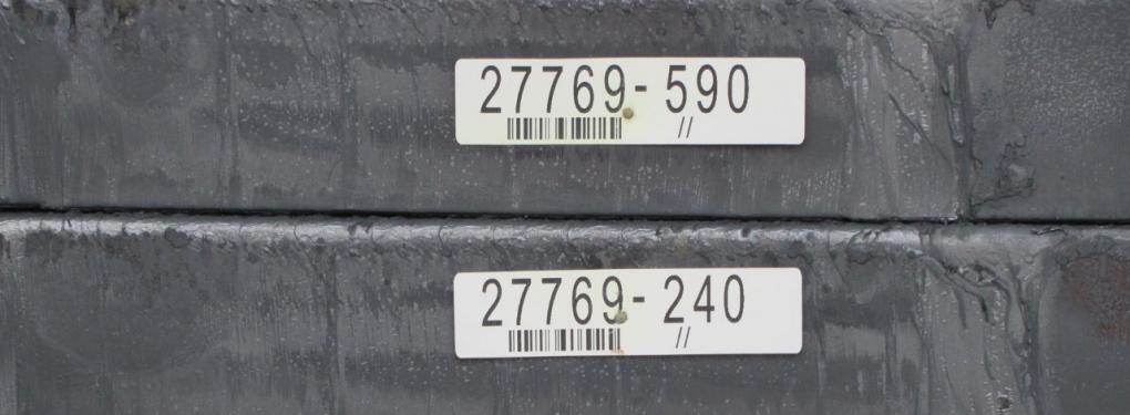 Metal Tags Nailed to Slabs